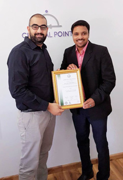URSME Jojith Jose (right) presents the HACCP certificate to representative from Central Point Catering