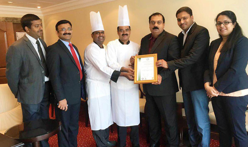 URS Middle East presents the HACCP certificate to the team of Sheraton Al Khalidiya